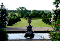 vista over fountain pool to formal topiary and informal countryside